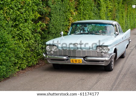 ROSMALEN, THE NETHERLANDS - MAY 16: A 1959 Chrysler New Yorker arriving on the Rock Around the Jukebox Open Air event on May 16, 2010 in Autotron Rosmalen in Holland.