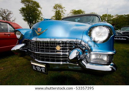 ROSMALEN, THE NETHERLANDS - MAY 16: 1955 Cadillac Eldorado Special Convertible on the Rock Around the Jukebox Open Air event on May 16, 2010 in Autotron Rosmalen, Holland. - stock photo