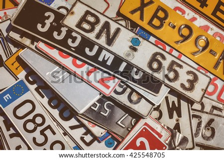 ROSMALEN, THE NETHERLANDS - MAY 8, 2016: Vintage European car license plates on a flee market in Rosmalen, The Netherlands - stock photo