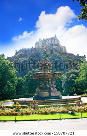Ross fountain and Edinburgh Castle in Scotland on summer day - stock photo