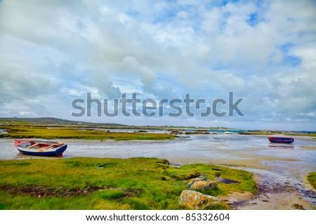 Rossadillisk Quay during low tide in summer, Conemara, Ireland. - stock photo