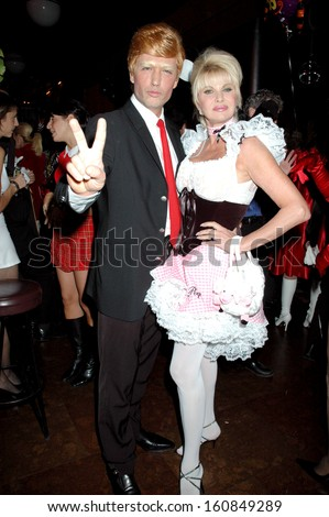 Rossano Rubicondi, dressed as Donald Trump, and Ivana Trump at the annual Michele and Frank Rella Halloween party, NY, October 28, 2004 - stock photo
