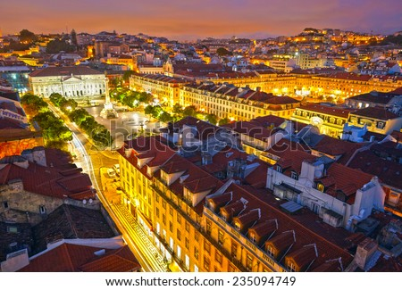 Rossio Square at night and Maria II Theatre. View from Santa Just elevador. Lisbon, Portugal - stock photo