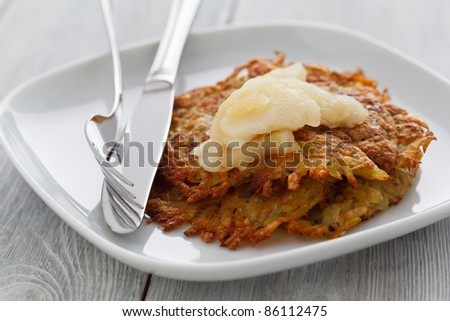 Rosti with apple compote on a wooden background. - stock photo