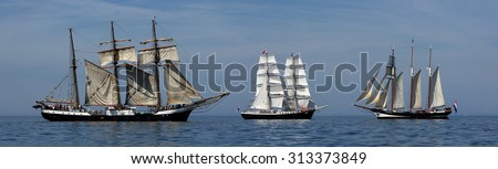 ROSTOCK, GERMANY - AUGUST 06, 2015 Old sailing ships Oosterschelde, Mercedes (NL) and Fridtjof Nansen (GER) sailing near Rostock on August 06, 2015 in the scope of the 25th Hanse-Sail Rostock, Germany - stock photo
