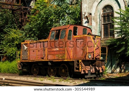 Rostov - on - Don, Russia - August 09, 2015: Old rusty Russian train in the territory of thrown factory, established near Green Island in Rostov - on - Don. - stock photo