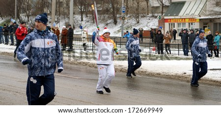 ROSTOV-ON-DON, RUSSIA - JANUARY 22: The Olympic Torch Relay in Rostov-on-Don, January 22, 2014 in Rostov-on-Don, Russia.