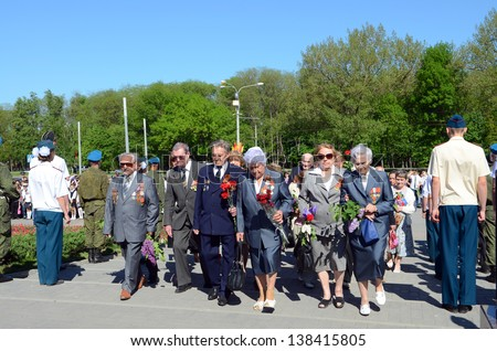 "ROSTOV-ON-DON, RUSSIA - MAY 7: The rally, placing flowers International automobile race ""Win one for all"" in honor of the Day of Victory in the WWII, May 7, 2013 in Rostov-on-Don, Russia"