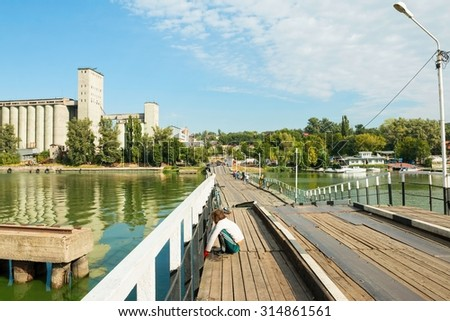Rostov - on - Don, Russia - September 09, 2015: Local fishermen fishing on the bridge. Water area of the Don river, established in Rostov - on - Don near Green Island.
