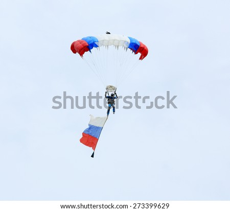 "ROSTOV REGION, RUSSIA - APRIL 18: Parachutist with the flag of Russia. International Festival of ecological tourism ""Celebrated steppe"" in Rostov region, Russia. April 18, 2015.  - stock photo"