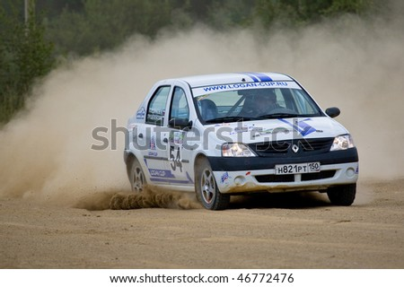 ROSTOV, RUSSIA - JULY 27: Andrey Sokolov drives a Renault Logan  car during Rostov Velikiy Russian rally championship on July 27, 2008 in Rostov, Russia. - stock photo
