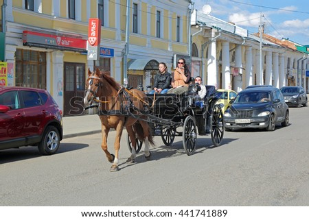 ROSTOV, YAROSLAVL OBLAST, RUSSIA - MAY 02, 2014: Cityscape, a horse harnessed to a cart on the street