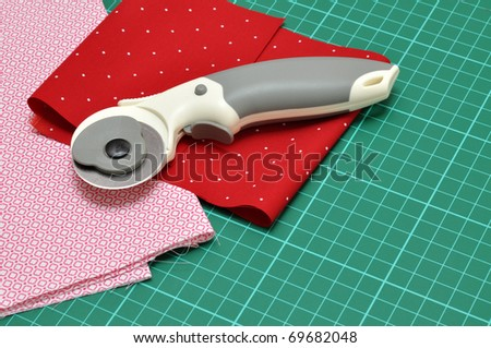 Rotary Cutter And Mat Drawing Rotary Cutter And Fabrics on a