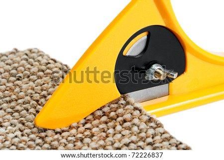 Rotary Cutter cuts carpeting - stock photo