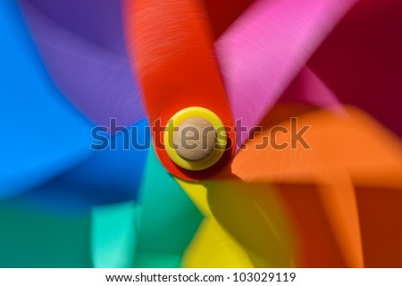 Rotating toy windmill - stock photo