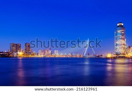 Roterdam Skyline with Erasmus Bridge at Twilight, The Netherlands - stock photo