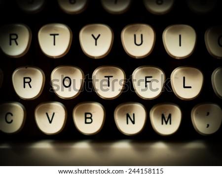 ROTFL internet slang concept - stock photo