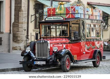 ROTHENBURG, GERMANY/EUROPE - SEPTEMBER 26 : Old fashioned red bus in Rothenburg Germany on September 26, 2014 - stock photo