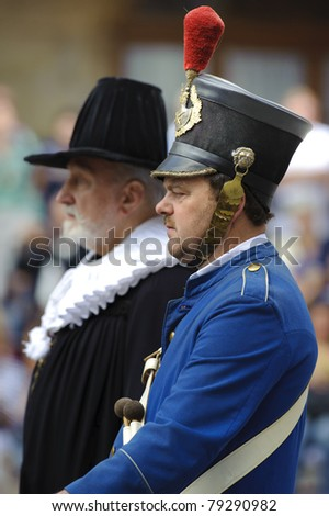 "ROTHENBURG OB DER TAUBER, GERMANY - JUNE 12: performer of annual medieval parad ""Meistertrunk"", dressed in historical costume as mayor and soldier at June 12, 2011 in Rothenburg ob der Tauber, Germany"