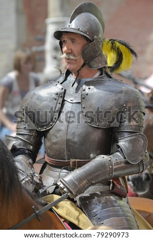 "ROTHENBURG OB DER TAUBER, GERMANY - JUNE 12: performer of annual medieval parade ""Meistertrunk"", dressed in historical costume as soldier on horse at June 12, 2011 in Rothenburg ob der Tauber, Germany"