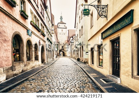 ROTHENBURG OB DER TAUBER, GERMANY - MARCH 05: Typical street on March 05, 2016 in Rothenburg ob der Tauber, Germany. It is well known for its well-preserved medieval old town. - stock photo