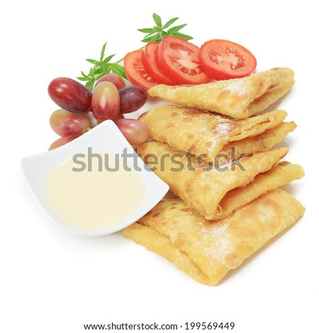 Roti canai, tisu, traditional south Indian flatbread called chapati with vegetable isolated on white background. - stock photo