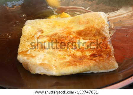 roti while frying on pan