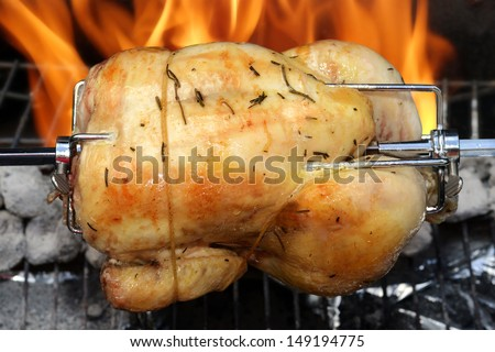 rotisserie chicken on the grill - stock photo