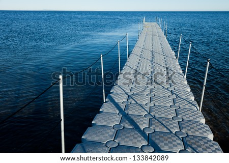 Rotomolding new design plastic boat dock - stock photo