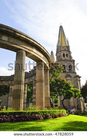 Rotonda de los Jalisciences Ilustres and Cathedral in historic center in Guadalajara, Jalisco, Mexico - stock photo