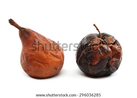 Rotten apple and pear isolated on white background. - stock photo
