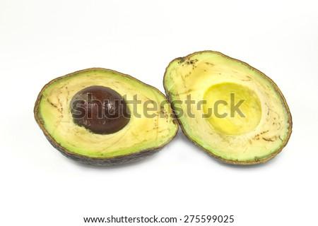 rotten avocado on white screen - stock photo