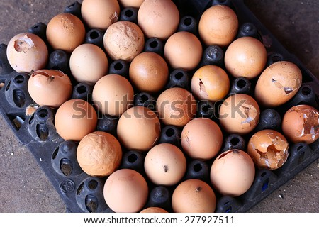 rotten eggs on tray - stock photo