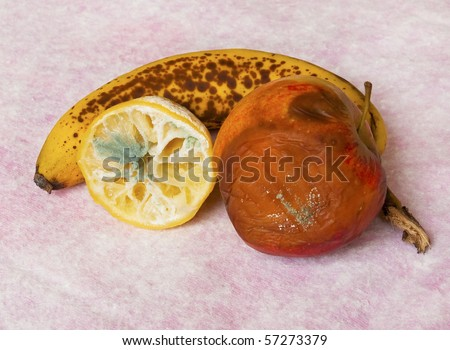 stock-photo-rotten-fruit-lemon-apple-and