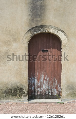 Rotten old French door with modern letterbox - stock photo