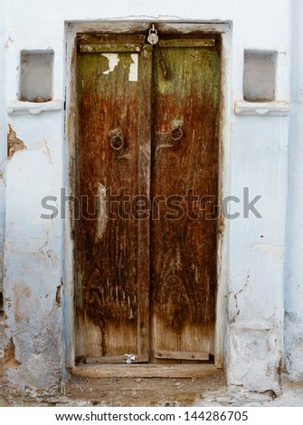 Rotten wooden grunge door of an old house. India, Udaipur