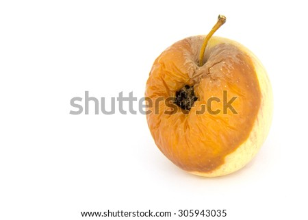 rotten yellow apple with bite mark on white background