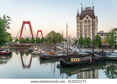 Rotterdam City, Oude Haven oldest part of the harbour, historic ship yard dock, Old Ship, Openlucht Binnenvaart Museum, Haringvliet and the Willemsbrug bridge at Dusk in Summer, Netherlands - stock photo