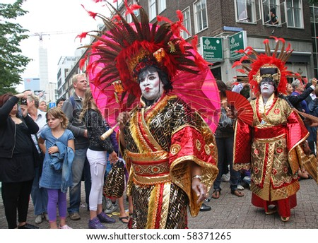 ROTTERDAM, HOLLAND - JULY 31: People in Japanese dress at the parade of the annual Summer Carnival in Rotterdam on July 31, 2010 in Rotterdam, Holland
