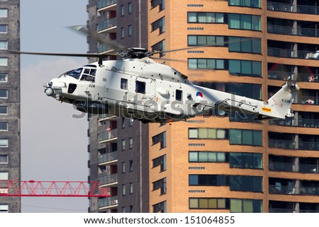 ROTTERDAM, HOLLAND - SEPTEMBER 8: Demonstration of a rescue operation by a Dutch Navy NH90 helicopter during the World Harbor Days in Rotterdam, Holland on September 8, 2012  - stock photo