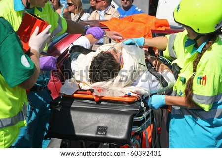 ROTTERDAM, HOLLAND - SEPTEMBER 5: Demonstration of handling of car crash victim by medics at the annual World Harbor Days in Rotterdam, Holland on September 5, 2010 - stock photo