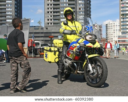 ROTTERDAM, HOLLAND - SEPTEMBER 5: Medic on motorbike at the annual World Harbor Days in Rotterdam, Holland on September 5, 2010 - stock photo