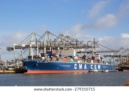 ROTTERDAM - JAN 13, 2012: CMA CGM Alaska container ship moored at the ECT Terminal in Rotterdam. The port is the Europ's largest and facilitate the needs of a hinterland with 40,000,000 consumers. - stock photo