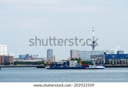 ROTTERDAM-JULY. 4:Container ship entering Port of Rotterdam,on July 4,2014,This harbor is the largest port in Europe Covering 105 sq. KM and stretches over a distance of 40 KM.