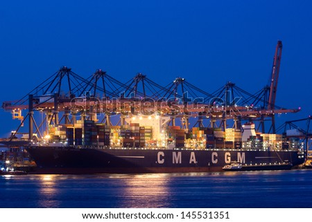 ROTTERDAM - JULY 9: Container ship in the Port of Rotterdam on July 9, 2012. Rotterdam is with it���´s 105 square km the largest port in Europe. - stock photo