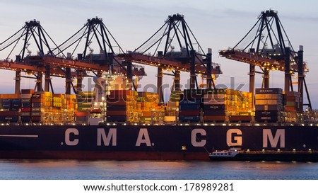 ROTTERDAM - JULY 9: Container ship in the Port of Rotterdam on July 9, 2012. Rotterdam is with it's 105 square km the largest port in Europe.  - stock photo
