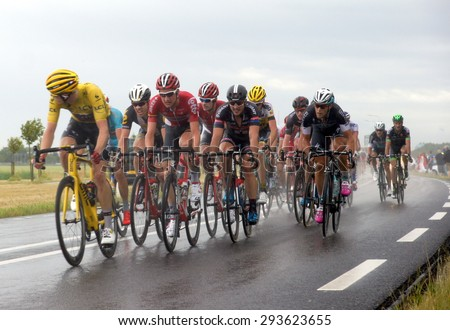 ROTTERDAM-JULY 5: Cyclists from various teams cycle in heavy showers of rain during Stage 2 of the Tour de France from Utrecht to  Zelande  on July 5 2015 in Rotterdam, Netherlands  - stock photo