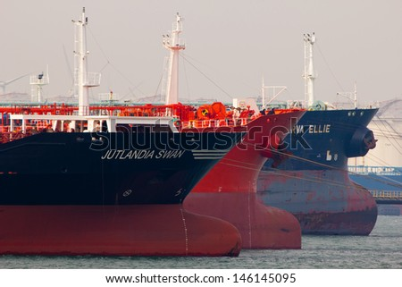 ROTTERDAM - MARCH 19: Oil-tankers docking on March 19, 2012 in Rotterdam, Holland. The port of Rotterdam plays a dominant role in the international transfer and refinement of crude oil  - stock photo