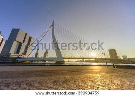 ROTTERDAM, 13 March 2016 - Sunset on Erasmus Bridge in Rotterdam captured from the New Meuse river island - stock photo