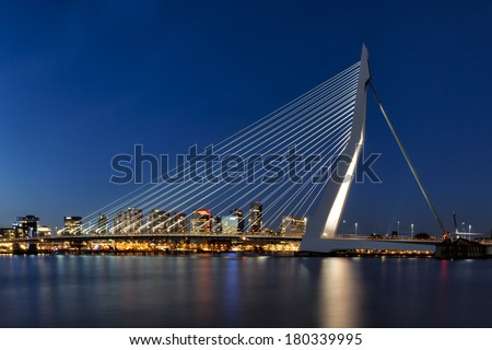 "ROTTERDAM - MARCH 5: The Erasmus Bridge, also known as ""The Swan"", is one of the most well known landmarks in the skyline of Rotterdam, the Netherlands on March 5, 2014. - stock photo"